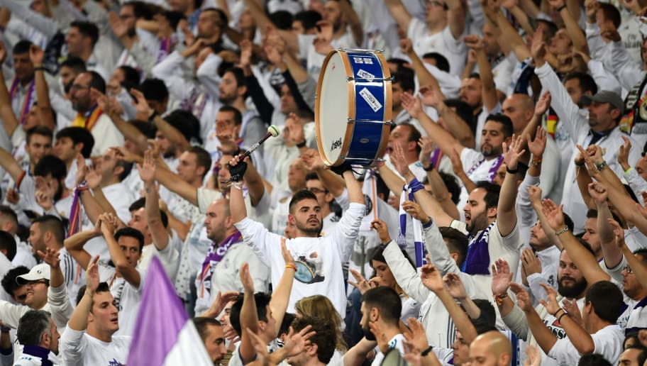MADRID,SPAIN - OCTOBER 23: Fans of Real Madrid cheer during the Group G match of the UEFA Champions League between Real Madrid and Viktoria Plzen at Bernabeu on October 23, 2018 in Madrid, Spain. (Photo by Etsuo Hara/Getty Images)