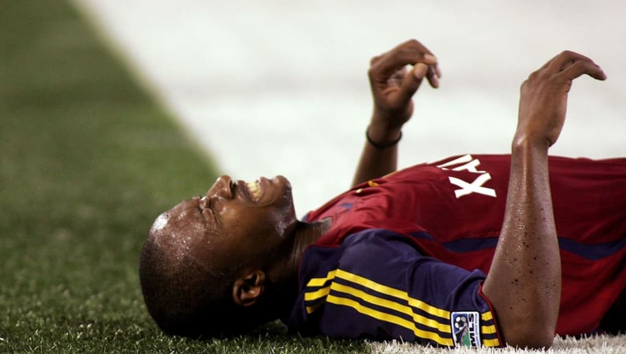 EAST RUTHERFORD, NJ - SEPTEMBER 29: Eddie Pope #23 of the Real Salt Lake lies on the ground in pain after being tripped up against the New York Red Bulls at Giants Stadium in the Meadowlands on September 29, 2007 in East Rutherford, New Jersey. (Photo by Mike Stobe/Getty Images for New York Red Bull)