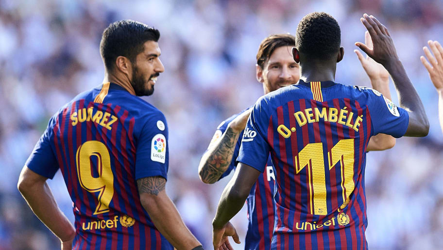 SAN SEBASTIAN, SPAIN - SEPTEMBER 15:  Ousmane Dembele of FC Barcelona celebrates with his teammates Lionel Messi and Luis Suarez of FC Barcelona after scoring his team's second goal during the La Liga match between Real Sociedad de Futbol and FC Barcelona at Estadio Anoeta on September 15, 2018 in San Sebastian, Spain.  (Photo by Juan Manuel Serrano Arce/Getty Images)