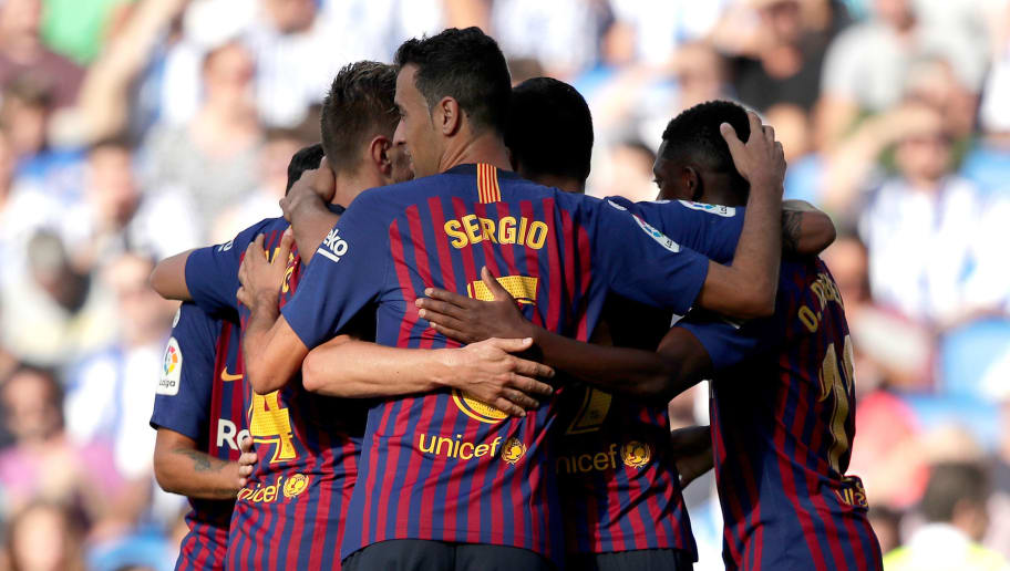 SAN SEBASTIAN, SPAIN - SEPTEMBER 15: (L-R) Philippe Coutinho of FC Barcelona, Ousmane Dembele of FC Barcelona, Samuel Umtiti of FC Barcelona, Ivan Rakitic of FC Barcelona, Sergio Busquets of FC Barcelona celebrates during the La Liga Santander  match between Real Sociedad v FC Barcelona at the Estadio Anoeta on September 15, 2018 in San Sebastian Spain (Photo by David S. Bustamante/Soccrates/Getty Images)