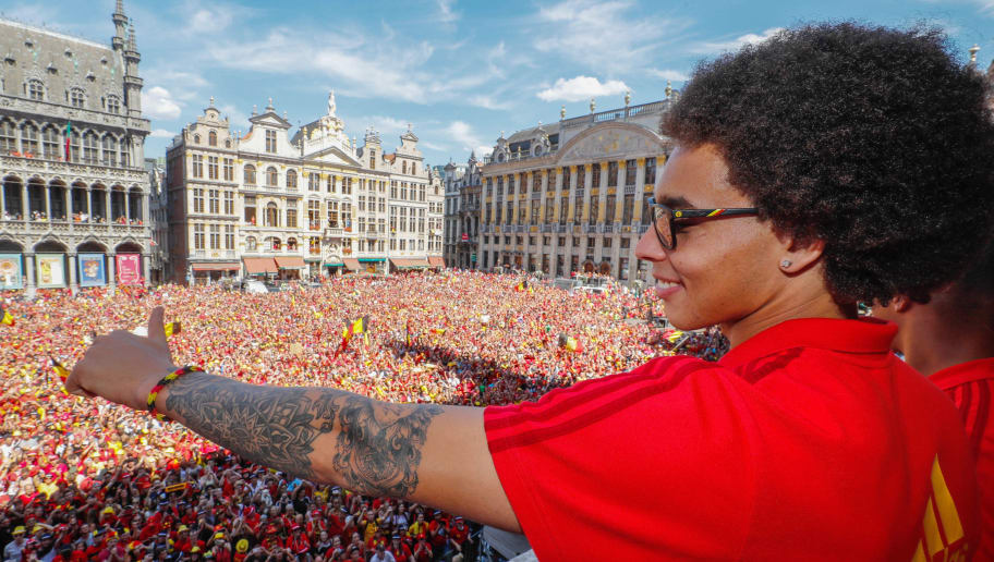 BRUSSEL, BELGIUM - JULY 15:  Belgian soccer team player Axel Witsel celebrates on the balcony of the city hall at the Brussels' Grand Place, after taking the third place in the World Cup 2018 on July 15, 2018 in Brussels, Belgium.  (Photo by Yves Herman/Royal Belgium Pool/Getty Images)