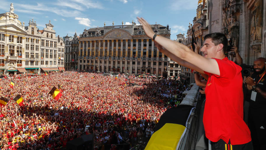 BRUSSELS, BELGIUM - JULY 15:  Belgian soccer team player Thibaut Courtois celebrate on the balcony of the city hall at the Brussels' Grand Place, after taking the third place in the World Cup 2018 on July 15, 2018 in Brussels, Belgium.  (Photo by Yves Herman/Royal Belgium Pool/Getty Images)
