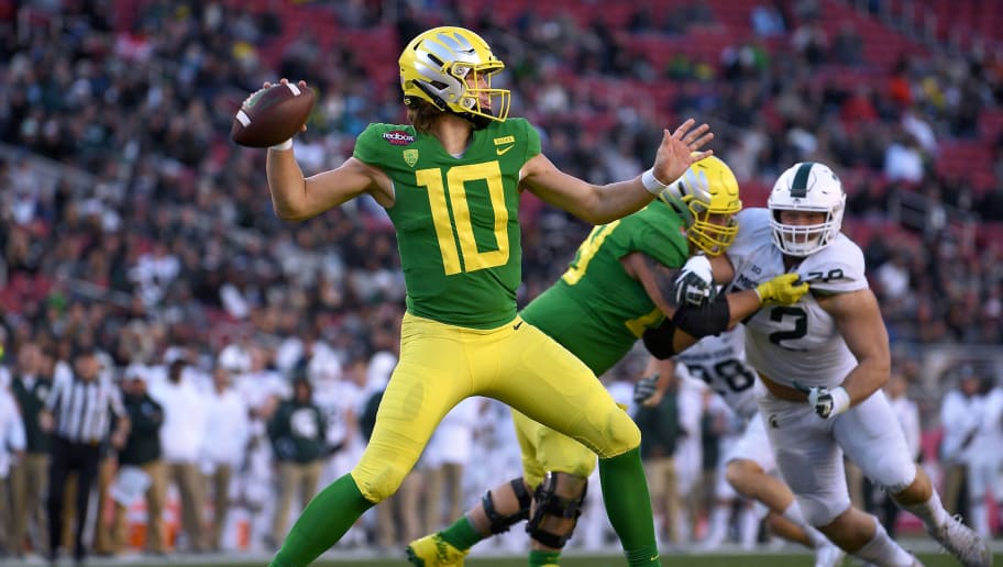 SANTA CLARA, CA - DECEMBER 31:  Justin Herbert #10 of the Oregon Ducks looks to pass against the Michigan State Spartans during the second half of the Redbox Bowl at Levi's Stadium on December 31, 2018 in Santa Clara, California.  (Photo by Thearon W. Henderson/Getty Images)
