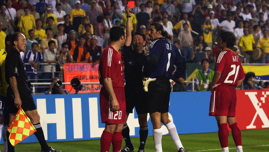 Referee Young Joo Kim of South Korea and  Hakan Unsal of Turkey