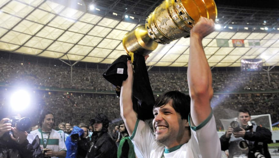 RESTRICTIONS / EMBARGO - ONLINE CLIENTS MAY USE UP TO SIX IMAGES DURING EACH MATCH WITHOUT THE AUTHORISATION OF THE DFB. NO MOBILE USE DURING THE MATCH AND FOR A FURTHER TWO HOURS AFTERWARDS IS PERMITTED WITHOUT THE AUTHORISATION OF THE DFB  Werder Bremen's Brazilian midfielder Diego clebrates with the trophy after the men's DFB German Cup final football match Werder Bremen vs Bayer Leverkusen on May 30, 2009 at the Olympic stadium in Berlin. Werder Bremen won 1-0 with a goal by Mezut Oezil and is German Cup winner.  AFP PHOTO  DDP / MICHAEL GOTTSCHALK   GERMANY OUT (Photo credit should read MICHAEL GOTTSCHALK/AFP/Getty Images)