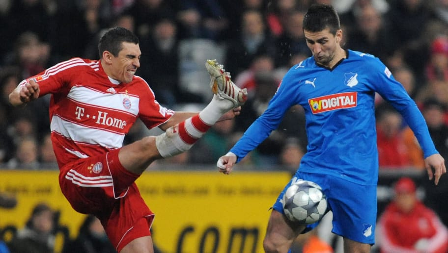RESTRICTIONS / EMBARGO - ONLINE CLIENTS MAY USE UP TO SIX IMAGES DURING EACH MATCH WITHOUT THE AUTHORISATION OF THE DFL. NO MOBILE USE DURING THE MATCH AND FOR A FURTHER TWO HOURS AFTERWARDS IS PERMITTED WITHOUT THE AUTHORISATION OF THE DFL. Bayern Munich's Brazilian defender Lucio (L) and Hoffenheim's Bosnian striker Vedad Ibisevic vies for the ball during the German first division Bundesliga football match FC Bayern Munich vs.TSG 1899 Hoffenheim at the Allianz Arena in Munich, southern Germany, on December 5,  2008.     AFP PHOTO    DDP / OLIVER LANG  GERMANY OUT (Photo credit should read OLIVER LANG/AFP/Getty Images)