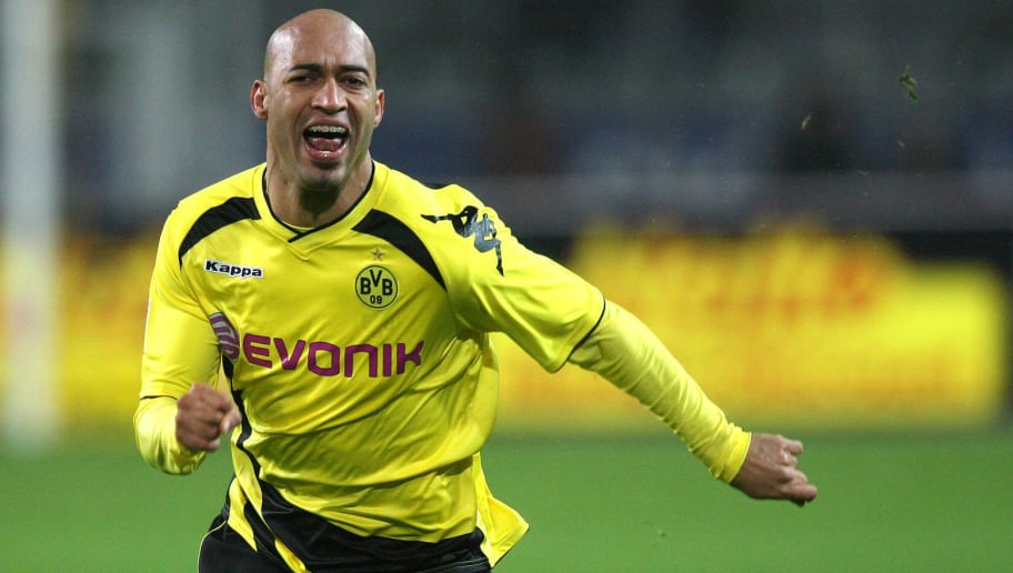RESTRICTIONS / EMBARGO - ONLINE CLIENTS MAY USE UP TO SIX IMAGES DURING EACH MATCH WITHOUT THE AUTHORISATION OF THE DFL. NO MOBILE USE DURING THE MATCH AND FOR A FURTHER TWO HOURS AFTERWARDS IS PERMITTED WITHOUT THE AUTHORISATION OF THE DFL.Dortmund's Brazilian defender Dede celebrates after the German first division Bundesliga football match Borussia Dortmund vs Hamburg SV in the western German city of Dortmund on November 12, 2010. Dortmund won the match 2-0. AFP PHOTO / PATRIK STOLLARZ (Photo credit should read PATRIK STOLLARZ/AFP/Getty Images)
