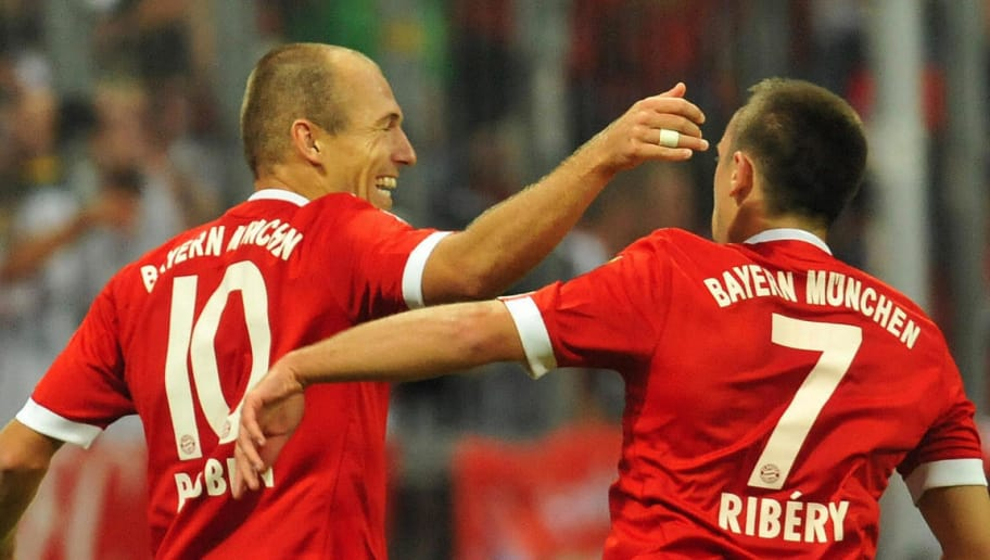 RESTRICTIONS / EMBARGO - ONLINE CLIENTS MAY USE UP TO SIX IMAGES DURING EACH MATCH WITHOUT THE AUTHORISATION OF THE DFL. NO MOBILE USE DURING THE MATCH AND FOR A FURTHER TWO HOURS AFTERWARDS IS PERMITTED WITHOUT THE AUTHORISATION OF THE DFL. Bayern Munich's French midfielder Franck Ribery congratulates Bayern Munich's new Dutch striker Arjen Robben (L) on scoring during the German first division Bundesliga football match FC Bayern Munich vs VfL Wolfsburg in the southern German city of Munich on August 29, 2009. Bayern Munich won the match 3-0. AFP PHOTO DDP / OLIVER LANG GERMANY OUT (Photo credit should read OLIVER LANG/AFP/Getty Images)