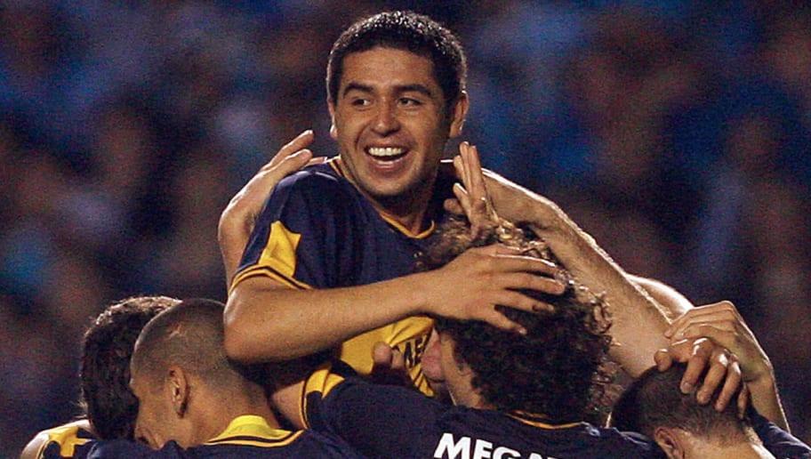 Riquelme of Boca Juniors celebrates his...