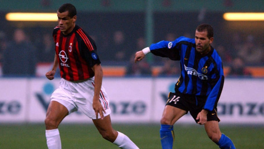 Rivaldo of AC Milan and Luigi Di Biagio of Inter Milan