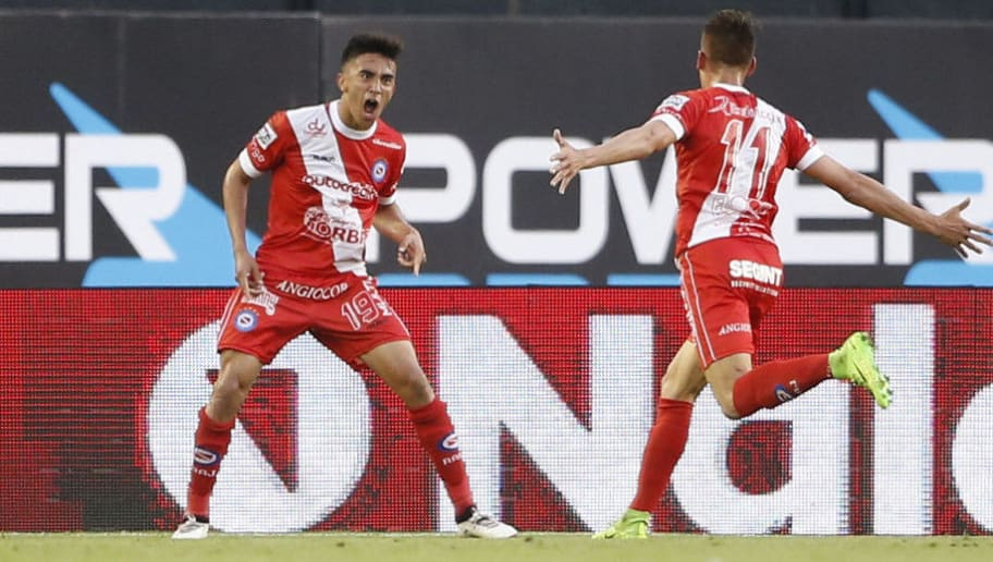 BUENOS AIRES, ARGENTINA - SEPTEMBER 24: Nicolas Gonzalez of Argentinos Juniors celebrates with teammate Braian Romero after scoring the first goal of his team during a match between River Plate and Argentinos Juniors as part of the Superliga 2017/18 at Monumental Stadium on September 24, 2017 in Buenos Aires, Argentina. (Photo by Gabriel Rossi/Getty Images)