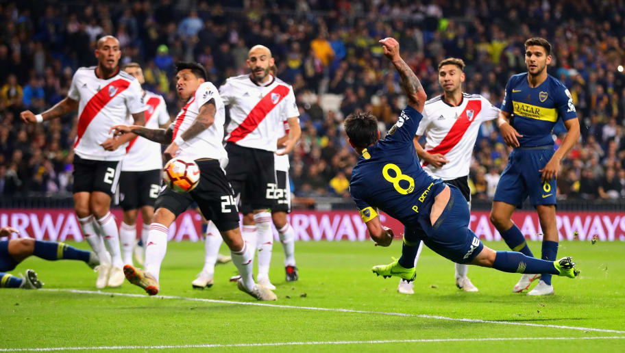 MADRID, SPAIN - DECEMBER 09: Pablo Javier Perez of Boca Juniors takes a shot during the second leg of the final match of Copa CONMEBOL Libertadores 2018 between Boca Juniors and River Plate at Estadio Santiago Bernabeu on December 9, 2018 in Madrid, Spain. Due to the violent episodes of November 24th at River Plate stadium, CONMEBOL rescheduled the game and moved it out of Americas for the first time in history.  (Photo by Chris Brunskill/Fantasista/Getty Images)