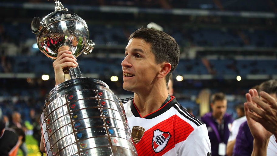 MADRID, SPAIN - DECEMBER 09:  Ignacio Fernandez of River Plate celebrates with the trophy at the end of the second leg of the final match of Copa CONMEBOL Libertadores 2018 between Boca Juniors and River Plate at Estadio Santiago Bernabeu on December 9, 2018 in Madrid, Spain. Due to the violent episodes of November 24th at River Plate stadium, CONMEBOL rescheduled the game and moved it out of Americas for the first time in history. (Photo by Matthew Ashton - AMA/Getty Images)