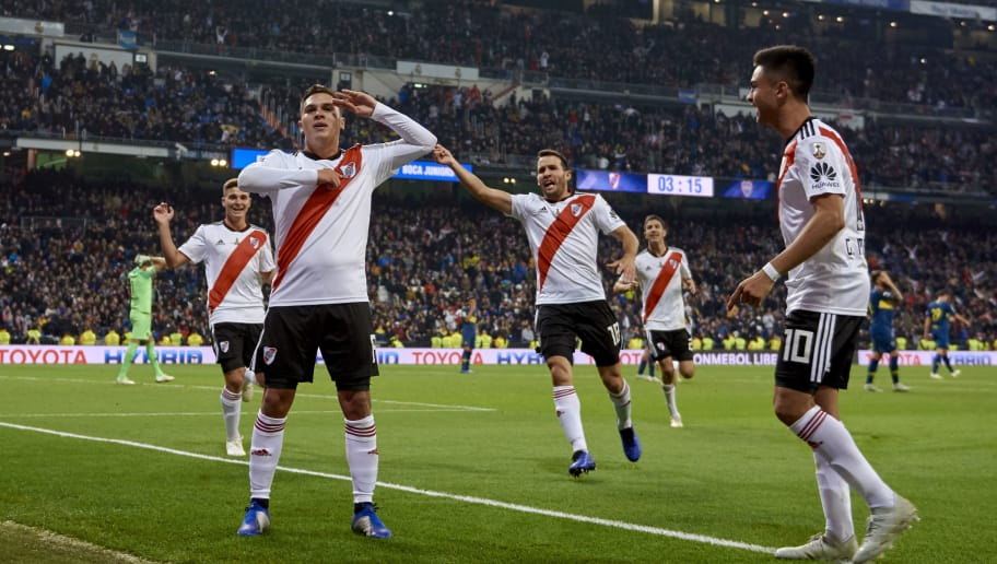 MADRID, SPAIN - DECEMBER 09: Juan Quintero of River Plate celebrates with his team-mates after scoring his team's second goal during the second leg of the final match of Copa CONMEBOL Libertadores 2018 between Boca Juniors and River Plate at Estadio Santiago Bernabeu on December 09, 2018 in Madrid, Spain. Due to the violent episodes of November 24th at River Plate stadium, CONMEBOL rescheduled the game and moved it out of Americas for the first time in history. (Photo by Quality Sport Images/Getty Images,)