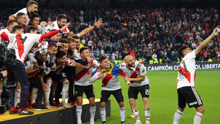 MADRID, SPAIN - DECEMBER 09:   Gonzalo Martinez of River Plate takes a selfie with his team-mates at the end of the second leg of the final match of Copa CONMEBOL Libertadores 2018 between Boca Juniors and River Plate at Estadio Santiago Bernabeu on December 9, 2018 in Madrid, Spain. Due to the violent episodes of November 24th at River Plate stadium, CONMEBOL rescheduled the game and moved it out of Americas for the first time in history. (Photo by Matthew Ashton - AMA/Getty Images)