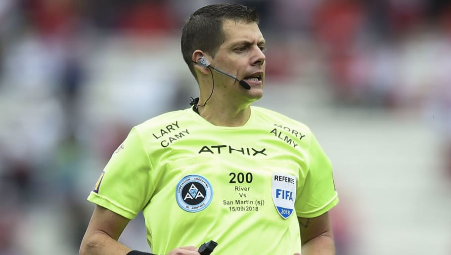 BUENOS AIRES, ARGENTINA - SEPTEMBER 15: Referee German Delfino looks on during a match between River Plate and San Martin de San Juan as part of Superliga 2018/19 at Estadio Monumental Vespucio Liberti on September 15, 2018 in Buenos Aires, Argentina.  (Photo by Marcelo Endelli/Getty Images)