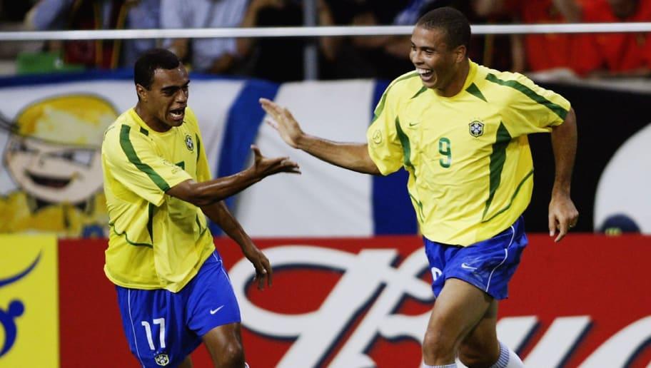 Ronaldo of Brazil celebrates his goal with team-mate Denilson