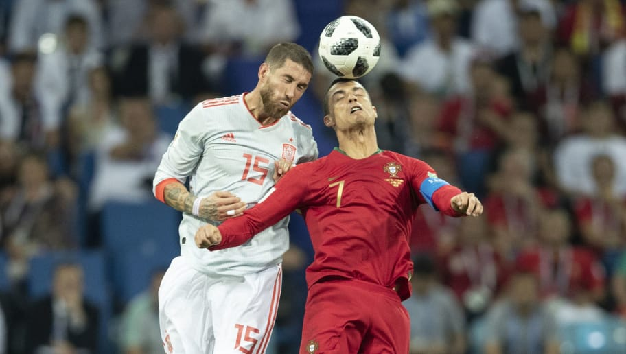 SOCHI, RUSSIA - JUNE 15:  Cristiano Ronaldo of Portugal is challenged by  Sergio Ramos of Spain during the 2018 FIFA World Cup Russia group B match between Portugal and Spain at Fisht Stadium on June 15, 2018 in Sochi, Russia.  (Photo by XIN LI/Getty Images)