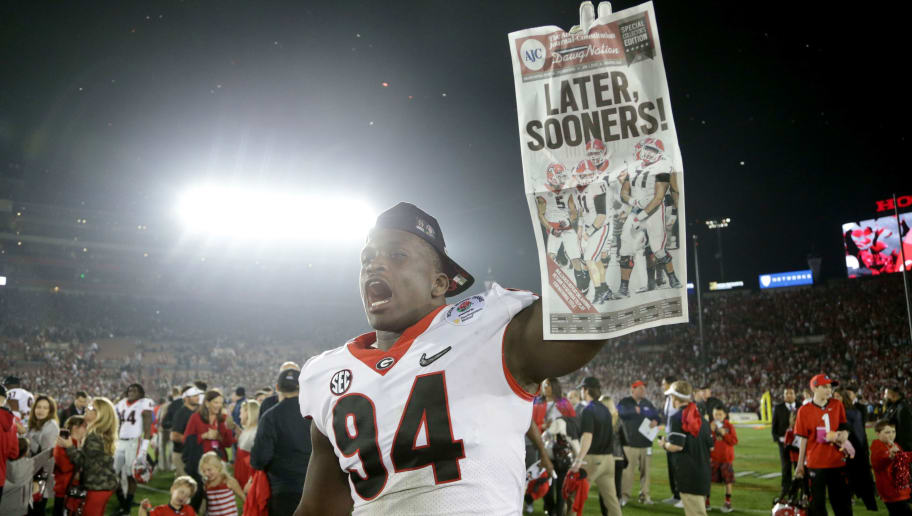 PASADENA, CA - JANUARY 01:  Michael Barnett #94 of the Georgia Bulldogs holds up a newspaper after the Bulldogs beat the Oklahoma Sooners 54-48 in the 2018 College Football Playoff Semifinal at the Rose Bowl Game presented by Northwestern Mutual at the Rose Bowl on January 1, 2018 in Pasadena, California.  (Photo by Jeff Gross/Getty Images)