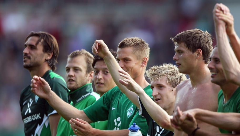 AHLEN, GERMANY - AUGUST 14:  (L-R) Hugo Almeida, Daniel Jensen, Mesut Oezil, Marko Arnautovic, Marko Marin and Sebastian Boenisch of Bremen celebrate the 4-0 victory after the DFB Cup first round match between Rot Weiss Ahlen and SV Werder Bremen at Werse Stadium on August 14, 2010 in Ahlen, Germany.  (Photo by Christof Koepsel/Bongarts/Getty Images)