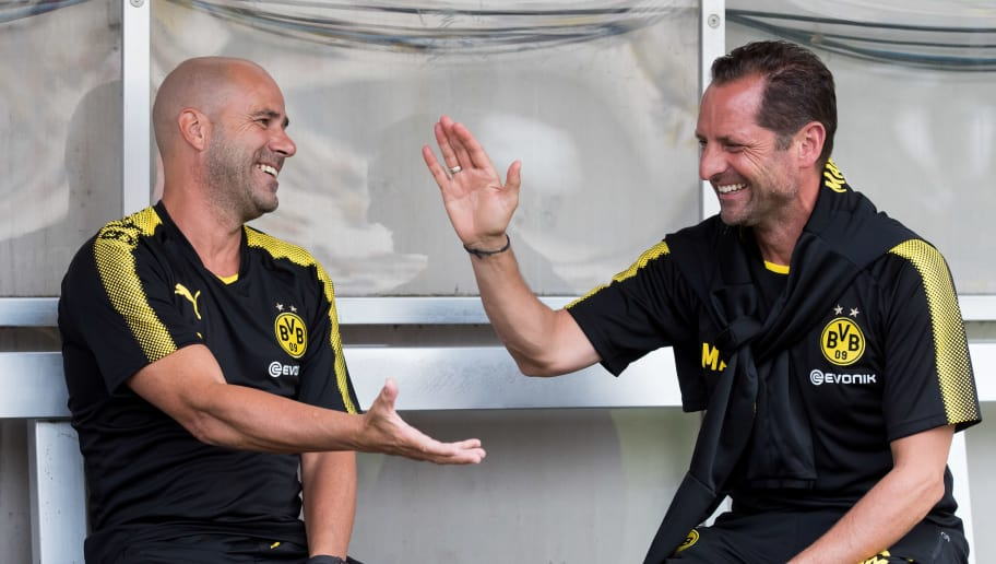 ESSEN, GERMANY - JULY 11: Head coach Peter Bosz of Dortmund shakes hands with Massimo Mariotti of Dortmund during the preseason friendly match between Rot-Weiss Essen and Borussia Dortmund at Stadion Essen on July 11, 2017 in Essen, Germany. (Photo by TF-Images/TF-Images via Getty Images)