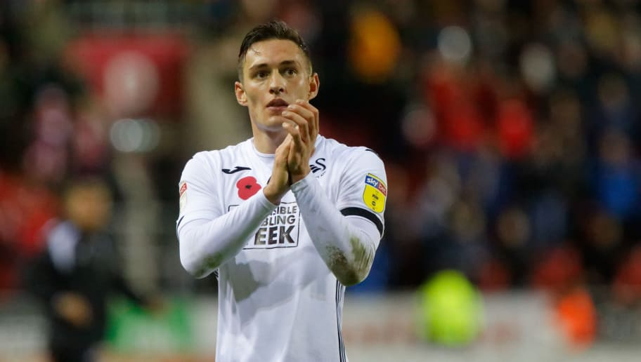 ROTHERHAM, ENGLAND - NOVEMBER 03: Connor Roberts of Swansea City thanks away supporters during the Sky Bet Championship match between Rotherham United and Swansea City at the AESSEAL New York Stadium on November 03, 2018 in Rotherham, England. (Photo by Athena Pictures/Getty Images)
