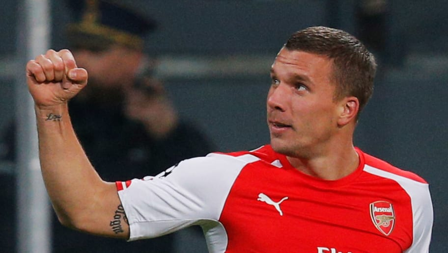 BRUSSELS, BELGIUM - OCTOBER 22:  Lukas Podolski of Arsenal (9) celebrates as he scores their second goal during the UEFA Champions League Group D match between RSC Anderlecht and Arsenal at Constant Vanden Stock Stadium on October 22, 2014 in Brussels, Belgium.  (Photo by Dean Mouhtaropoulos/Getty Images)
