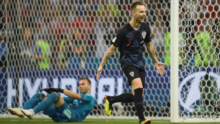 SOCHI, RUSSIA - JULY 07:  Ivan Rakitic of Croatia celebrates scoring the winning penalty during the 2018 FIFA World Cup Russia Quarter Final match between Russia and Croatia at Fisht Stadium on July 7, 2018 in Sochi, Russia.  (Photo by Shaun Botterill/Getty Images)