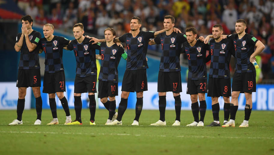 SOCHI, RUSSIA - JULY 07:  Croatia players look on from the half way line during the penalty shoot out during the 2018 FIFA World Cup Russia Quarter Final match between Russia and Croatia at Fisht Stadium on July 7, 2018 in Sochi, Russia.  (Photo by Laurence Griffiths/Getty Images)