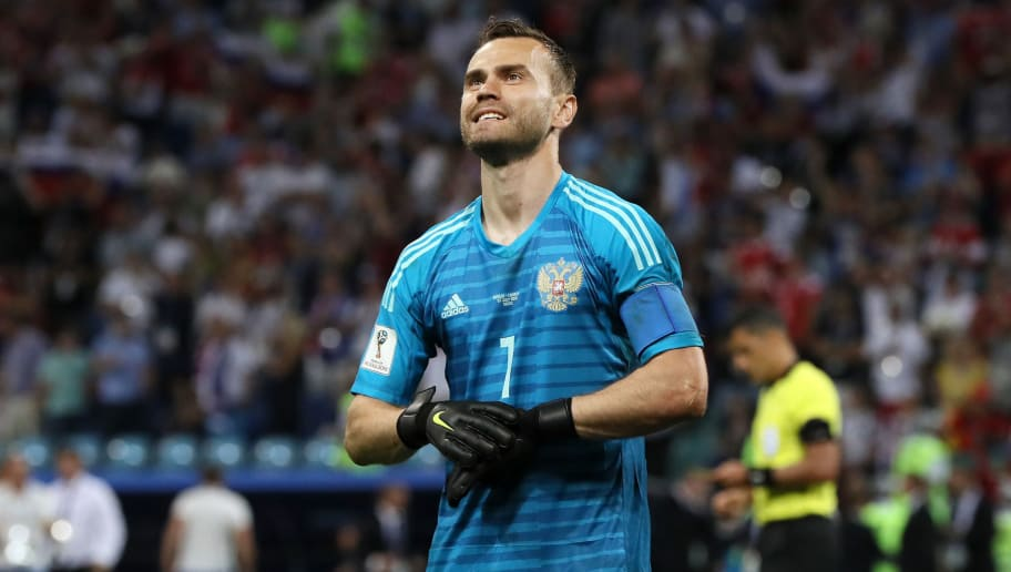 SOCHI, RUSSIA - JULY 07:  Igor Akinfeev of Russia celebrates after he saves the second penalty from Mateo Kovacic of Croatia in the penalty shoot out the 2018 FIFA World Cup Russia Quarter Final match between Russia and Croatia at Fisht Stadium on July 7, 2018 in Sochi, Russia.  (Photo by Kevin C. Cox/Getty Images)