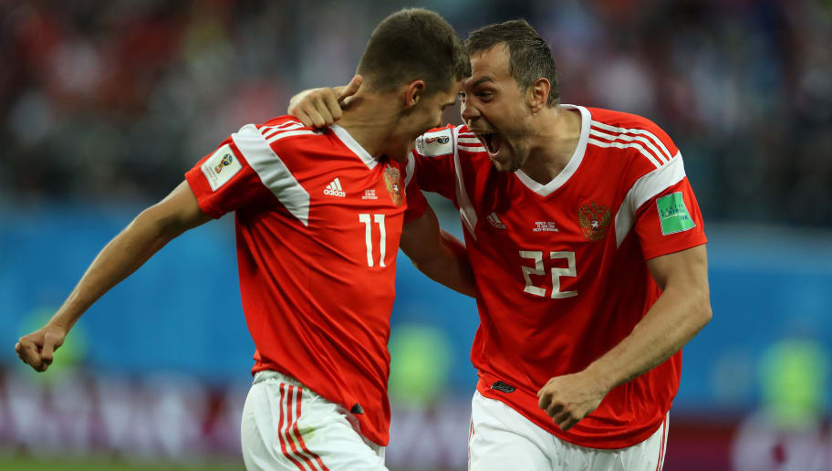 SAINT PETERSBURG, NULL - JUNE 19:  Artem Dzyuba and Roman Zobnin of Russia celebrate the first Russia goal, an own goal by Ahmed Fathi of Egypt, during the 2018 FIFA World Cup Russia group A match between Russia and Egypt at Saint Petersburg Stadium on June 19, 2018 in Saint Petersburg, Russia.  (Photo by Richard Heathcote/Getty Images)