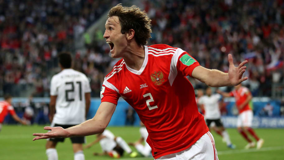 SAINT PETERSBURG, RUSSIA - JUNE 19:  Mario Fernandes of Russia celebrates the 2nd Russia goal scored by Denis Cheryshev of Russia during the 2018 FIFA World Cup Russia group A match between Russia and Egypt at Saint Petersburg Stadium on June 19, 2018 in Saint Petersburg, Russia.  (Photo by Julian Finney/Getty Images)