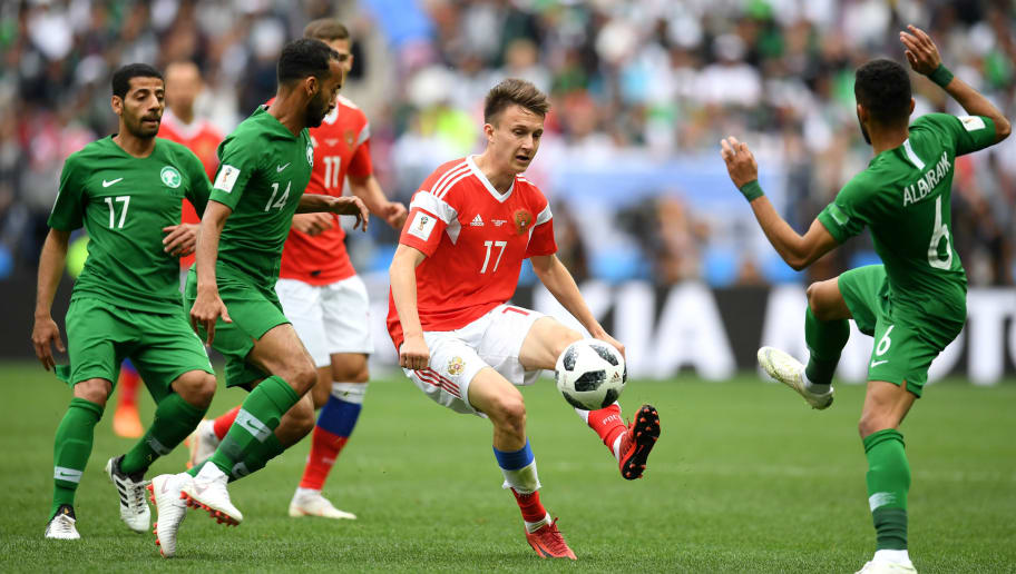 MOSCOW, RUSSIA - JUNE 14:  Aleksandr Golovin of Russia controls the ball under pressure of Mohammed Alburayk, Abdullah Otayf and Taiseer Aljassam of Saudi Arabia  during the 2018 FIFA World Cup Russia Group A match between Russia and Saudi Arabia at Luzhniki Stadium on June 14, 2018 in Moscow, Russia.  (Photo by Matthias Hangst/Getty Images)