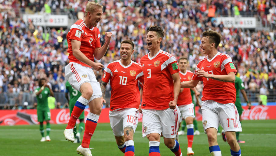 MOSCOW, RUSSIA - JUNE 14:  Iury Gazinsky of Russia celebrates with teammates Fedor Smolov, Ilya Kutepov and Aleksandr Golovin after scoring the opening goal during the 2018 FIFA World Cup Russia Group A match between Russia and Saudi Arabia at Luzhniki Stadium on June 14, 2018 in Moscow, Russia.  (Photo by Matthias Hangst/Getty Images)