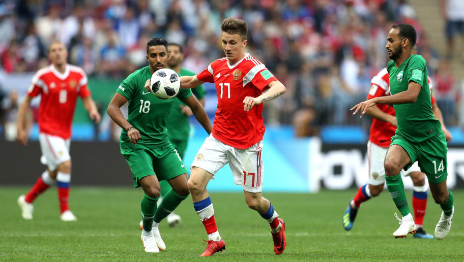 MOSCOW, RUSSIA - JUNE 14:  Aleksandr Golovin of Russia and Salem Aldawsari of Saudi Arabia battle for possession during the 2018 FIFA World Cup Russia Group A match between Russia and Saudi Arabia at Luzhniki Stadium on June 14, 2018 in Moscow, Russia.  (Photo by Catherine Ivill/Getty Images)