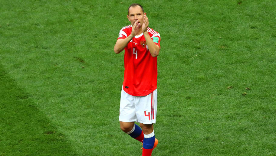 MOSCOW, RUSSIA - JUNE 14:  Sergey Ignashevich of Russia acknowledges the fans at the end  the 2018 FIFA World Cup Russia group A match between Russia and Saudi Arabia at Luzhniki Stadium on June 14, 2018 in Moscow, Russia. (Photo by Robbie Jay Barratt - AMA/Getty Images)