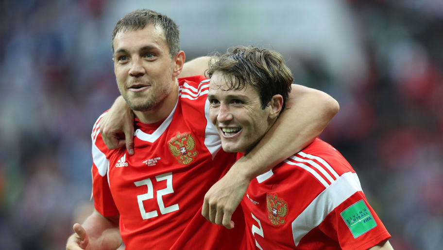MOSCOW, RUSSIA - JUNE 14: Artem Dzyuba and IMario Fernandes of Russia are seen during the 2018 FIFA World Cup Russia group A match between Russia and Saudi Arabia at Luzhniki Stadium on June 14, 2018 in Moscow, Russia. (Photo by Ian MacNicol/Getty Images)