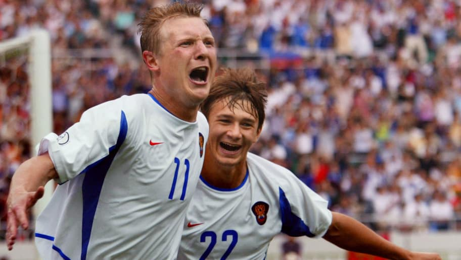 SHIZUOKA, JAPAN:  Russian forward Vladimir Beschastnykh (L) is congratulated by teammate forward Dmitri Sychev after he scored during the Group H first round last match Belgium/Russia of the 2002 FIFA World Cup in Korea and Japan, 14 June 2002 at Shizuoka Stadium.  AFP PHOTO ODD ANDERSEN (Photo credit should read Odd Andersen/AFP/Getty Images)