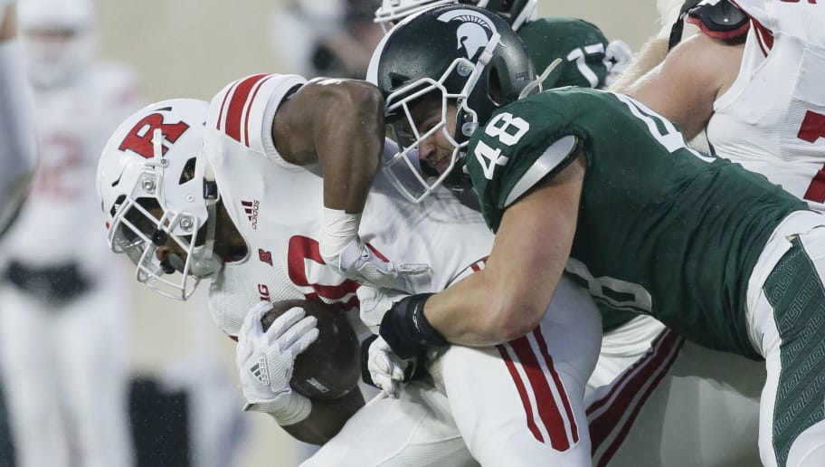 EAST LANSING, MI - NOVEMBER 24:  Running back Isaih Pacheco #10 of the Rutgers Scarlet Knights is tackled by defensive end Kenny Willekes #48 of the Michigan State Spartans during the first half at Spartan Stadium on November 24, 2018 in East Lansing, Michigan. Michigan State defeated Rutgers 14-10.  (Photo by Duane Burleson/Getty Images)