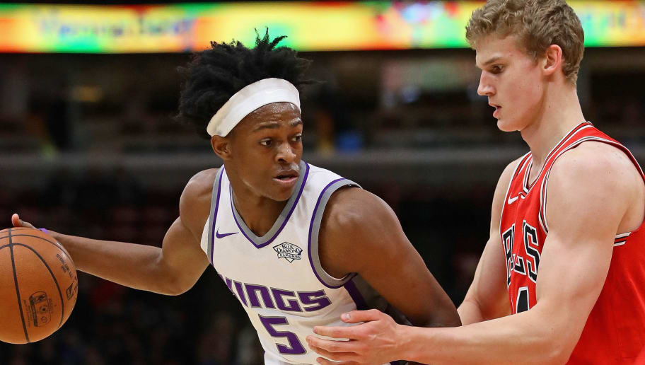 CHICAGO, IL - DECEMBER 01:  De'Aaron Fox #5 of the Sacramento Kings looks to pass against Lauri Markkanen #24 of the Chicago Bulls at the United Center on December 1, 2017 in Chicago, Illinois. The Kings defeated the Bulls 107-106. NOTE TO USER: User expressly acknowledges and agrees that, by downloading and or using this photograph, User is consenting to the terms and conditions of the Getty Images License Agreement. (Photo by Jonathan Daniel/Getty Images)