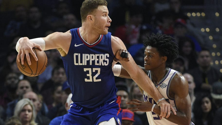 LOS ANGELES, CA - JANUARY 13: Blake Griffin #32 and of the Los Angeles Clippers is defended by De'Aaron Fox #5 of the Sacramento Kings during the second half at Staples Center on January 13, 2018 in Los Angeles, California. NOTE TO USER: User expressly acknowledges and agrees that, by downloading and or using this photograph, User is consenting to the terms and conditions of the Getty Images License Agreement. (Photo by Kevork Djansezian/Getty Images)