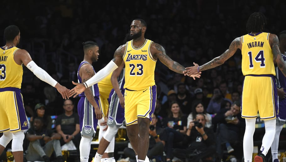 LOS ANGELES, CA - OCTOBER 04: LeBron James #23 of the Los Angeles Lakers is congratulated by his teammate Brandon Ingram #14 and Josh Hart #3 after scoring a basket and getting fouled against Sacramento Kings during the first half at Staples Center on October 4, 2018 in Los Angeles, California. NOTE TO USER: User expressly acknowledges and agrees that, by downloading and or using this photograph, User is consenting to the terms and conditions of the Getty Images License Agreement. (Photo by Kevork Djansezian/Getty Images)
