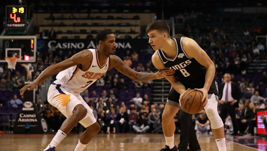 PHOENIX, ARIZONA - DECEMBER 04: Bogdan Bogdanovic #8 of the Sacramento Kings handles the ball guarded by Trevor Ariza #3 of the Phoenix Suns during the first half of the NBA game at Talking Stick Resort Arena on December 4, 2018 in Phoenix, Arizona.  NOTE TO USER: User expressly acknowledges and agrees that, by downloading and or using this photograph, User is consenting to the terms and conditions of the Getty Images License Agreement. (Photo by Christian Petersen/Getty Images)