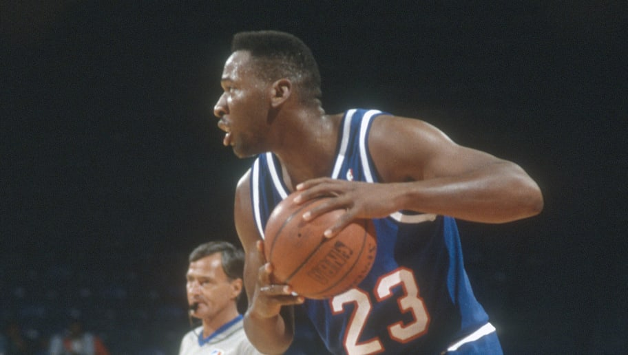 LANDOVER, MD - CIRCA 1991:  Wayman Tisdale #23 of the Sacramento Kings looks to pass the ball against the Washington Bullets during an NBA basketball game circa 1991 at the Capital Centre in Landover, Maryland. Tisdale played for the Kings from 1989-94. (Photo by Focus on Sport/Getty Images) *** Local Caption *** Wayman Tisdale
