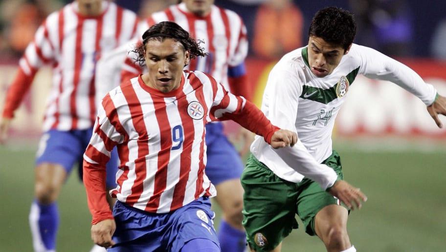 Salvador Cabanas (L) of team Paraguay ba