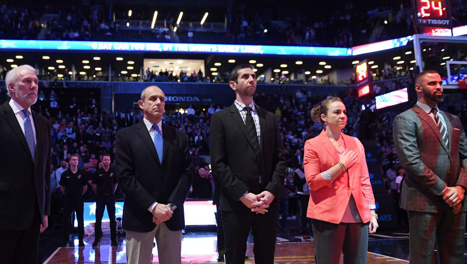 NEW YORK, NY - JANUARY 17: The coaching staff of the San Antonio Spurs (Gregg Popovich, Ettore Messina, James Borrego, Becky Hammon and Ime Udoka) lines up before the game against the Brooklyn Nets at Barclays Center on January 17, 2018 in Brooklyn, New York. NOTE TO USER: User expressly acknowledges and agrees that, by downloading and or using this photograph, User is consenting to the terms and conditions of the Getty Images License Agreement. (Photo by Matteo Marchi/Getty Images)