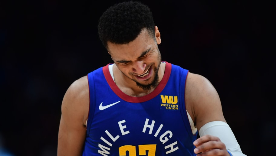 DENVER, CO - DECEMBER 28: Jamal Murray #27 of the Denver Nuggets is injured during the game against the San Antonio Spurs at Pepsi Center on December 28, 2018 in Denver, Colorado.  NOTE TO USER: User expressly acknowledges and agrees that, by downloading and or using this photograph, User is consenting to the terms and conditions of the Getty Images License Agreement. (Photo by Justin Tafoya/Getty Images)