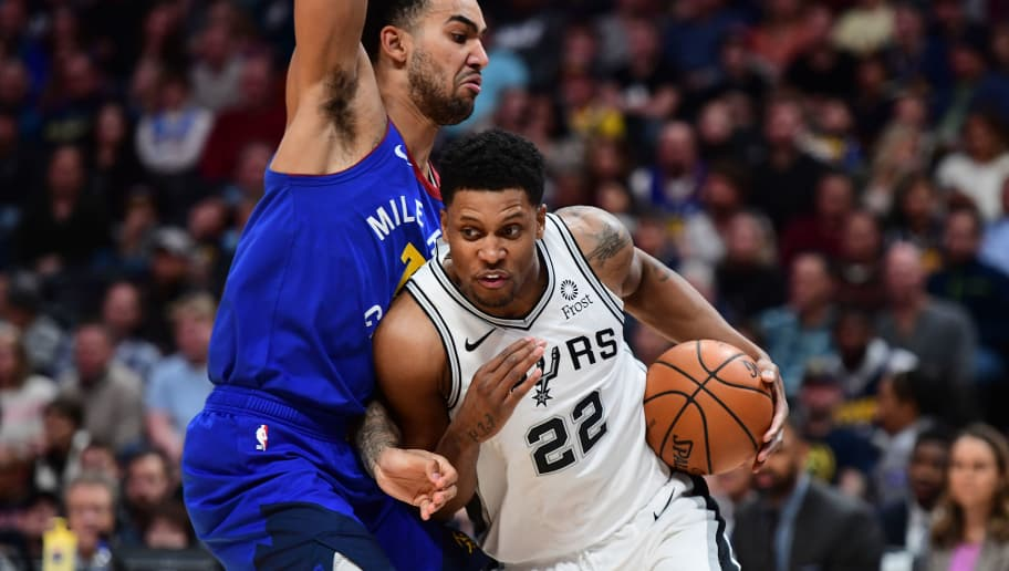 DENVER, CO - DECEMBER 28: Rudy Gay #22 of the San Antonio Spurs drives to the basket against Trey Lyles #7 of the Denver Nuggets at Pepsi Center on December 28, 2018 in Denver, Colorado.  NOTE TO USER: User expressly acknowledges and agrees that, by downloading and or using this photograph, User is consenting to the terms and conditions of the Getty Images License Agreement. (Photo by Justin Tafoya/Getty Images)
