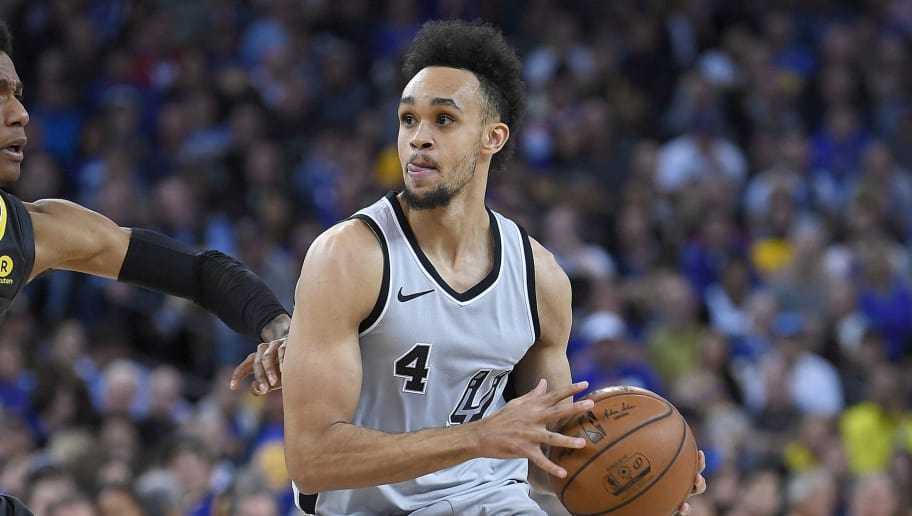 OAKLAND, CA - FEBRUARY 10:  Derrick White #4 of the San Antonio Spurs looks to drive on Patrick McCaw #0 of the Golden State Warriors during an NBA basketball game at ORACLE Arena on February 10, 2018 in Oakland, California. NOTE TO USER: User expressly acknowledges and agrees that, by downloading and or using this photograph, User is consenting to the terms and conditions of the Getty Images License Agreement.  (Photo by Thearon W. Henderson/Getty Images)