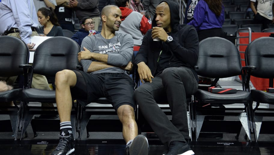 LOS ANGELES, CA - FEBRUARY 18: Tony Parker #9 of the San Antonio Spurs and Thierry Henry (R), former Arsenal, French professional football player, hang out before the start of the basketball game against the Los Angeles Clippers at Staples Center February 18, 2016, in Los Angeles, California. NOTE TO USER: User expressly acknowledges and agrees that, by downloading and or using the photograph, User is consenting to the terms and conditions of the Getty Images License Agreement. (Photo by Kevork Djansezian/Getty Images)